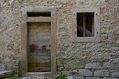 A disused building in hill village of Erto in Friuli Venezia Giulia north east Italy. The village is famous locally for having being evacuated following the 1963 Vajont Dam disaster. poster