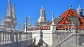 The rooftop of Sao Vicente de Fora Church with ornately decorated sections in the Baroque style, Lisbon, Portugal poster