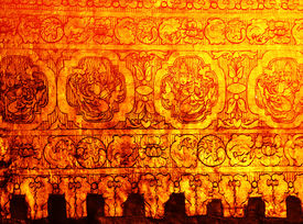 A gold leaf pattern on the wall of old stupa (Mandalay, Myanmar)