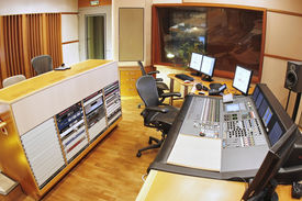 A shot of a professional recording studio, complete with technical equipment.