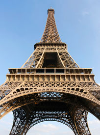 Eiffel Tower in Paris (France) on a beautiful sunny day