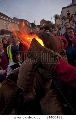 Two Young Roller Exchange A Burning Tar Barrel At The Start Of The 2011 Tar Barrels Of Ottery Carniv