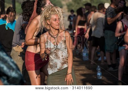 Riomalo De Abajo, Extremadura, Spain - July 13, 2018: A Beautiful Young Blonde Woman Dances On The M