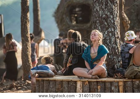 Riomalo De Abajo, Extremadura, Spain - July 13, 2018: A Woman Meditates At Dusk Near One Of The Scen