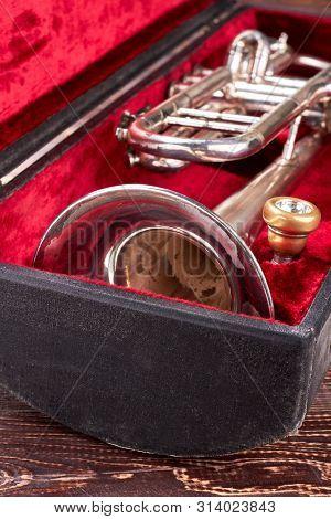 Old Trumpet In Velvet Box. Vintage Symphonic Trumpet. Classical Orchestra Instrument.