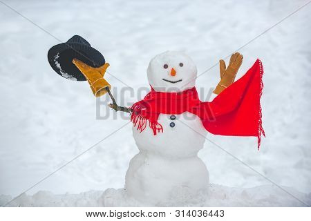Hello Winter. Christmas Snowman Close Up With Scarf. New Year Greeting Card. Snow Men. Snowman In Sn