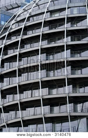 Side Of Rounded Steel Office Building With Balconies