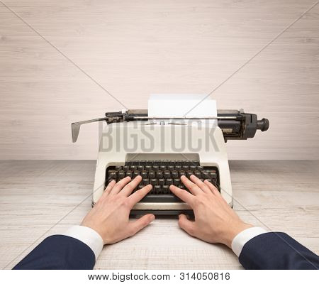 First person perspective elegant hand writing on an oldschool typewriter with copyspace