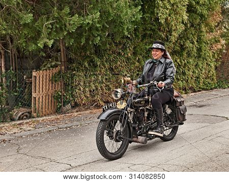 Ravenna, Italy - April 15, 2018: Biker Woman Riding Vintage Ajs G2 800 Cc V-twin Engine (1926) In Cl