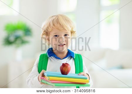 Child Going Back To School. Kid With Backpack.