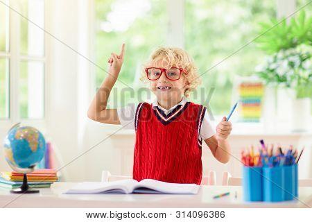 Kids Doing Homework. Children Go Back To School.