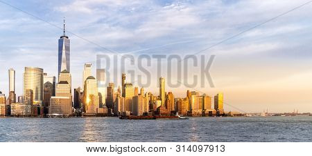 Panorama New York city Manhattan skyline cityscape at sunset from New Jersey.