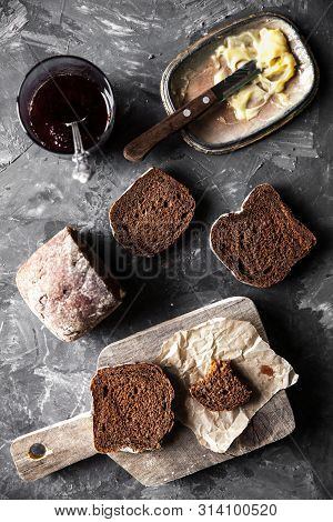 Bread With Butter And Jam In Vintage Style On A Dark Background A