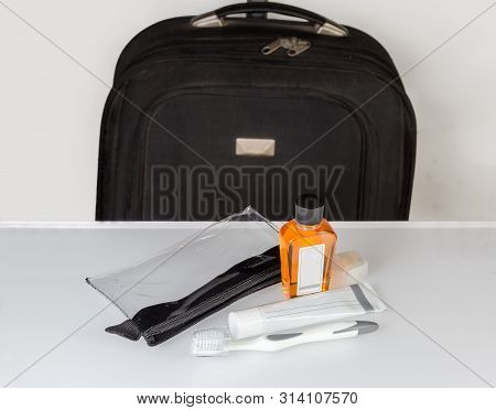 Toiletry Bag And Kit For Oral Hygiene Against Suitcase