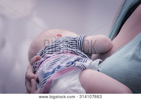 Baby Breastfeeding.  Mother Breastfeed Baby. New Born Baby Breastfeeding. Mother And Baby. Mother Br