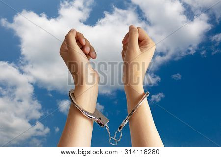Human Trafficking ,slave Labor And Labor Oppression Problems Concept. Two Hands Was Incarcerated By