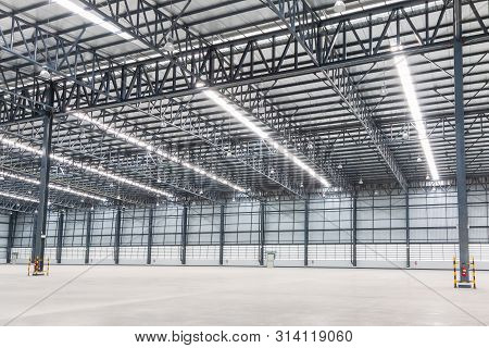 Empty Warehouse. Factory Building Or Warehouse Building With Concrete Floor For Industry. Industrial
