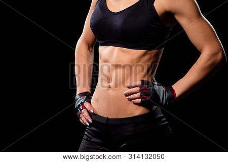 Attractive Ladys Fit Abdominal. Ladys Abs On Dark Background. Womans Muscular Torso And Abs. Minutes