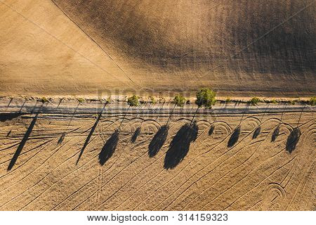 Abstract Drone View Of Famous Tuscan Hills In San Quirico Dorcia, Italy - Empty Agricultural Fields