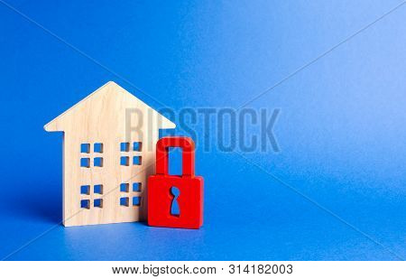 Wooden House And A Red Padlock. Security And Safety. Unavailable And Expensive Real Estate. House In