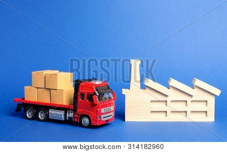 A Red Truck Loaded With Boxes Stands Near The Factory. Services Transportation Of Goods Products, Lo