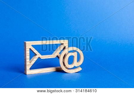 Envelope And Email Symbol On A Blue Background. Concept Email Address. Internet Technologies And Con