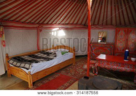 Gobi Desert, Mongolia - June 30, 2006: Tovshin Ger Interior, Nestled Below The Stunning Scenery Of T