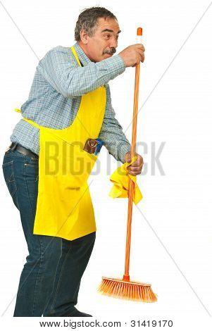 Senior Man Dancing With Broom