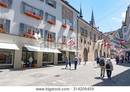 Chur, Gr / Switzerland - 29. July 2019: The Historic Old Town Of Chur With The Poststrasse Street Le
