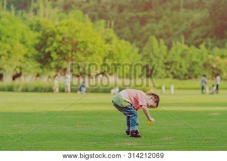Kanchanaburi Thailand - October 28 : Unidentified  Kid Enjoy With Little Ball On Green Field At Vill