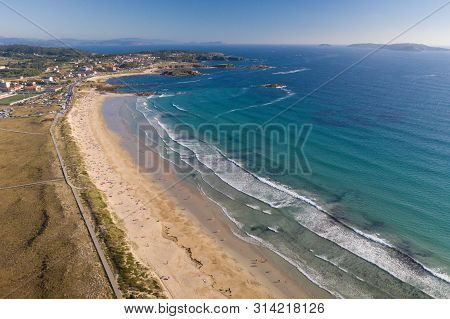 Ocean Waves, Sandy Beach With People Bathing In The Water, View From Drone, Lanzada Beach, Galicia,