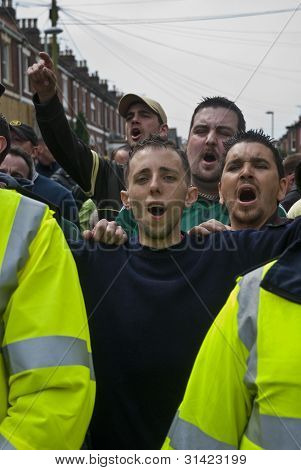 Plymouth Argyle Fans Shout At Rival Exeter City Supporters As They Are Escorted By Police At The Lea