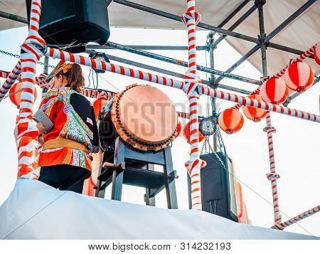 The Stage Of The Yagura With A Drummer Girl Big Japanese Taiko Drum Wadaiko. Paper Red-white Lantern