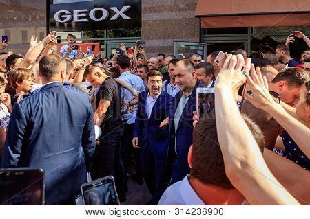 President Of Ukraine Volodymyr Zelenskyy (С) Talking To Locals In The City Center During A Working V