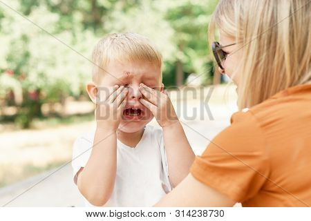 Sad Little Child, Toddler Boy, Hugging His Mother And Crying.  Family Concept. Emotions And State Of