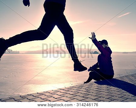 Woman Folowing Running Man At Lake Beach. Team Of Runners Man And Woman. In Couple Help Each Other E