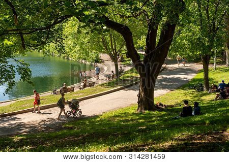 Montreal, Ca - 1 July 2019: People Enjoying A Warm Summer Day At The La Fontaine Park.
