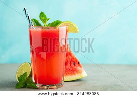 Watermelon Slushie With Lime And Mint, Summer Refreshing Drink In Tall Glasses On A Light Blue Backg