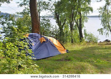 Camping Tent In Forest In The Karelian Isthmus, Leningrad Region, Russia.