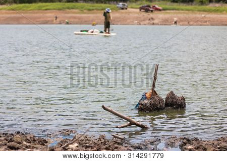 Villagers Are Searching For Fish At Land With Dry And Cracked Ground Because Dryness Global Warming,