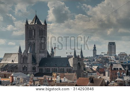 Gent, Flanders, Belgium -  June 21, 2019: Shot From Castle Tower, View Over City Roofs Shows Sint Ni