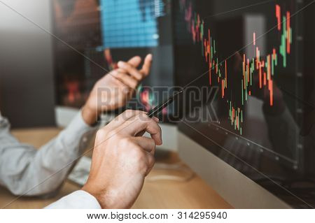 Business Team Investment Entrepreneur Trading Discussing And Analysis Graph Stock Market Trading,sto