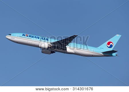 Sydney, Australia - October 7, 2013: Korean Air Boeing 777 Large Commercial Aircraft Climbing Out On