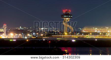 Sydney, Australia - October 10, 2013: Sydney Airport Air Traffic Control Tower At Night.
