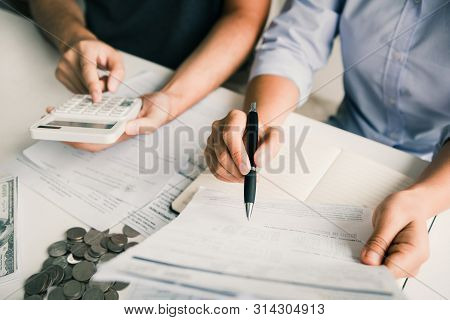 Two Asian Couples And Men And Women Are Together Analyzing Expenses Or Finances In Deposit Accounts
