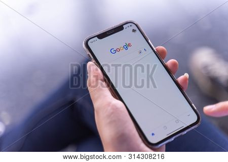 Chiang Mai, Thailand - Jul.27,2019: Woman Holding Apple Iphone Xs With Google Apps  For Searching On