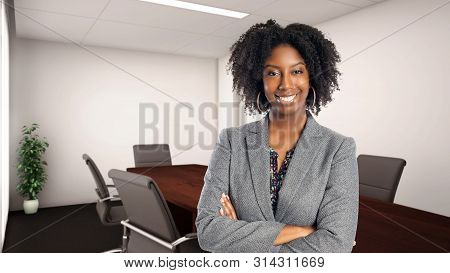 Black African American Businesswoman In An Office Looking Confident Or Arrogant.  She Is An Owner Or