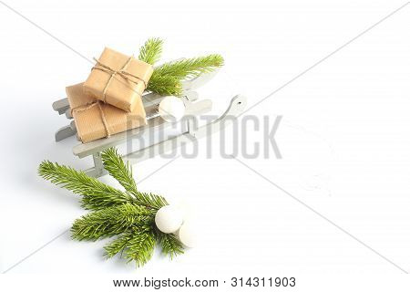 Christmas Sleigh With Gifts. New Years Concept. Decorative Toys In The Form Of White Balls And Green