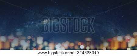 Blurred Night Sky Full Of Stars And City Bokeh Lights At Night. Abstract Bokeh Background, With Copy