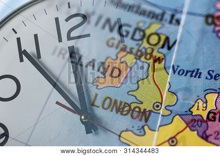 Double Composure Of United Kingdom On Globe And Clock-face In Concept Of Brexit